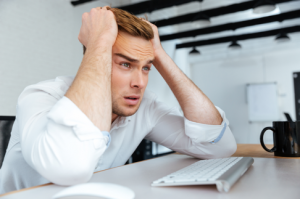 Man pulling his hair looking lost, the caption is overworked
