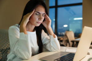 lady looking overwhelmed in front of a computer