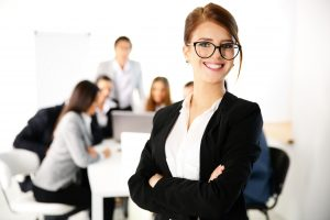 Portrait of a businesswoman standing in front of a business meeting
