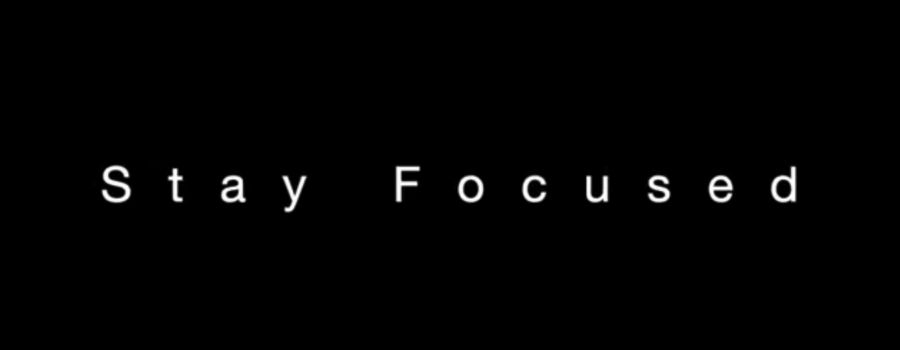 black background says stay focused in white letters